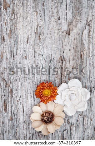 Grunge background with dry flowers on the old weathered wood - stock photo