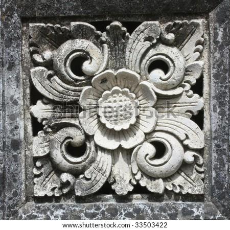 grunge Balinese stone sculpture, Floral design - stock photo