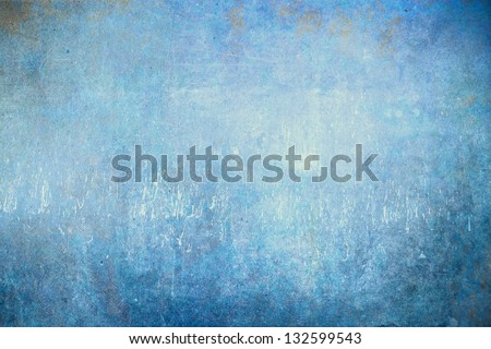 Grunge blue background with faded central area for copy space. - stock photo