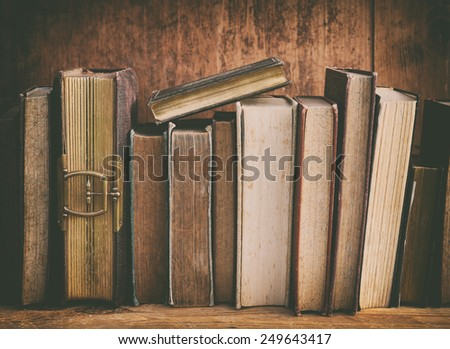 grunge bookshelf with old books. - stock photo