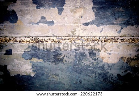 Grunge concrete wall with a rusty metal strip. Added noise - stock photo