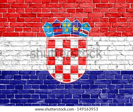 Grunge Croatia flag on brick wall - stock photo