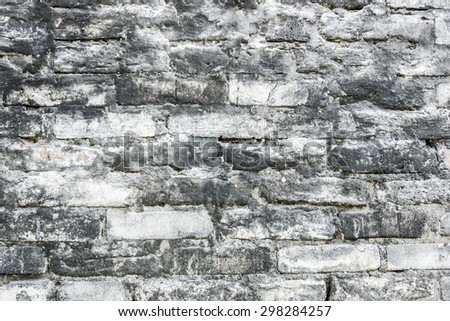 Grunge dirty black and white brick wall texture. - stock photo