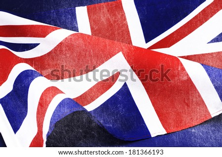 Grunge distressed aged old Union Jack British flag for D-Day 1944, 70th anniversary WWII, or 100th anniversary start of WWI events. - stock photo