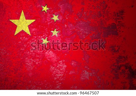 Grunge flag of China on cement wall - stock photo