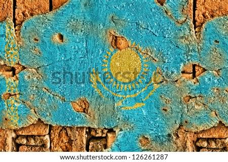 Grunge flag of Kazakhstan on old wall background. - stock photo