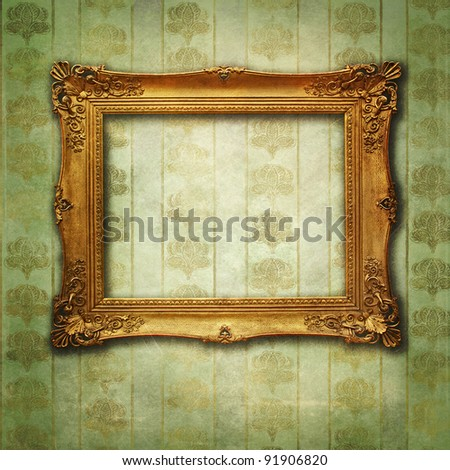 grunge floral faded wallpaper with golden vintage empty frame - stock photo
