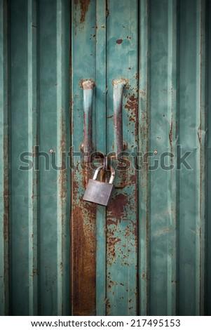 grunge green door lock with key - stock photo