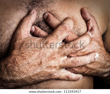 Grunge image of a topless man suffering a heart attack - stock photo