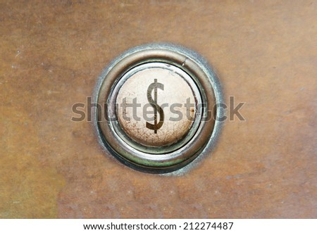 Grunge image of an old button - Dollar - stock photo