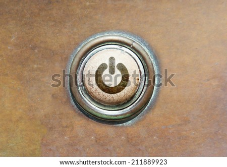 Grunge image of an old button - power - stock photo