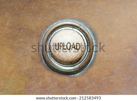 Grunge image of an old button - upload - stock photo