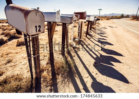 Grunge mail boxes in a row at Arizona desert USA - stock photo