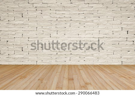 Grunge old aged brick wall painted in light cream beige color tone with wooden floor textured background in light natural yellow brown color tone for interior backgrounds     - stock photo
