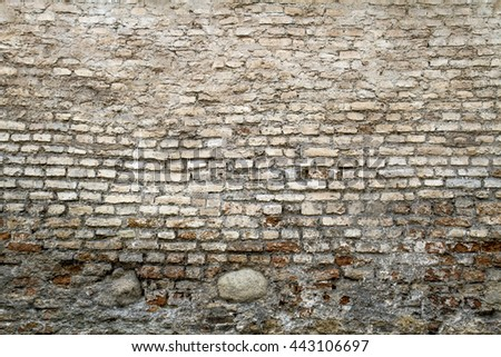Grunge old bricklaying wall fragment from red bricks and damaged plaster background texture for text or image. Close-up - stock photo
