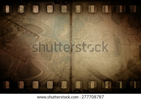 Grunge old motion picture reel with film strip. Vintage background - stock photo