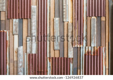 Grunge old wood and rusty roofing sheet wall background - stock photo