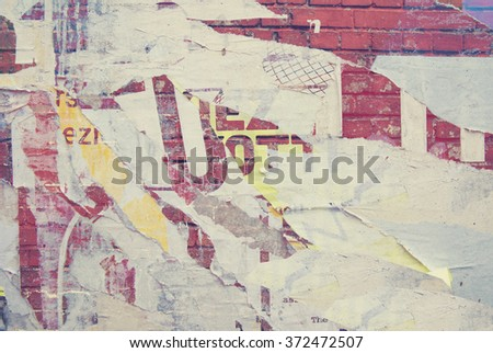grunge on billboard with vintage ripped posters  - stock photo