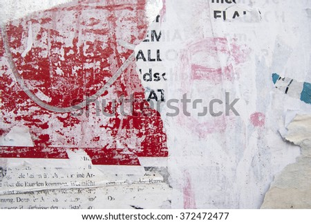 grunge on billboard with weathered ripped posters  - stock photo