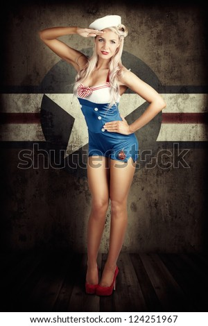 Grunge Portrait Of A Beautiful American Retro Female Cadet Dressed In Navy Uniform While Saluting In A Military Pin Up Girl Concept On Army Star Background - stock photo