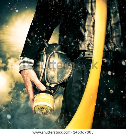Grunge portrait of a business man taking gas mask off after environmental disaster with long tie flying in the wind. Sky'??s the limit. New beginnings start here - stock photo