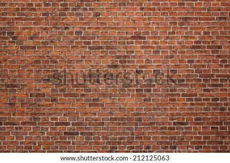 Grunge red brick wall background with copy space - stock photo