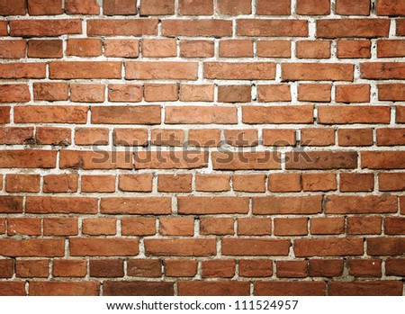 Grunge red brick wall with copy space - stock photo