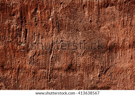 Grunge red wall texture with cracks and irregularities - stock photo