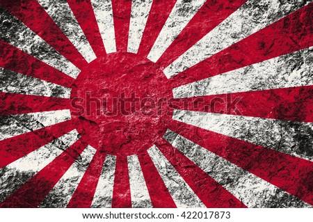 Grunge rising sun flag (Japan flag)on stone background - stock photo