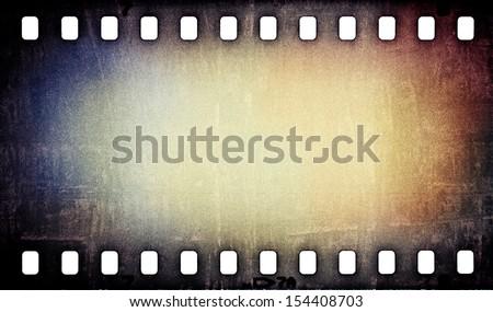 grunge scratched film strip background - stock photo