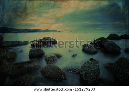 Grunge seascape with fantastic rock surface - stock photo
