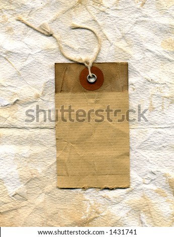 grunge shipping label. showing plenty of wear, stains and texture. on crumpled worn paper - stock photo