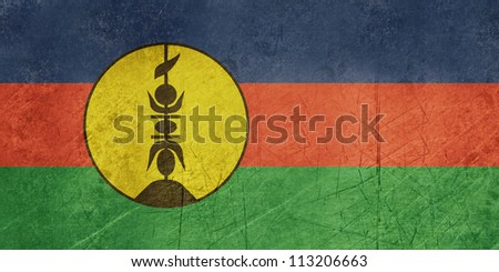 Grunge sovereign state flag of dependent country of New Caledonia in official colors. - stock photo
