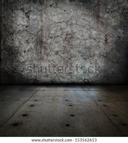 Grunge stone room. wall full of cracks. - stock photo