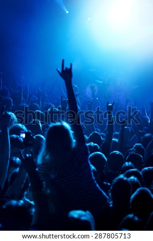 Grunge style photo, people hands raised up on musical concert - stock photo