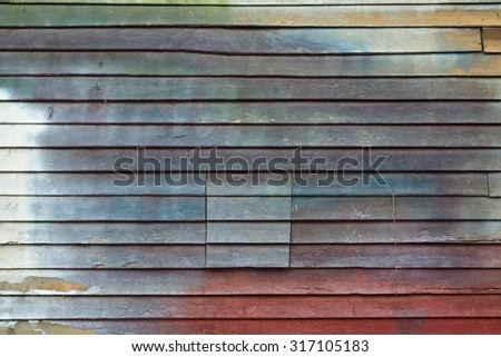 Grunge style Retro multicolor Painted wood wall for use as Background - stock photo