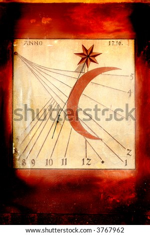 Grunge styled astronomical clock - sundial painted on the wall - stock photo
