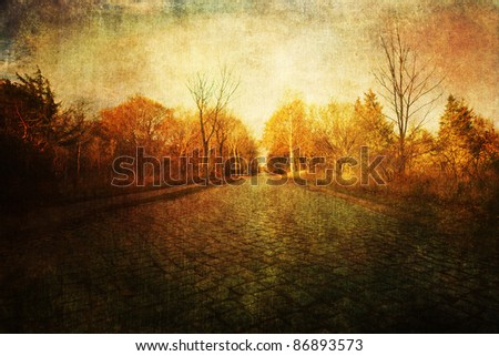 grunge textured picture of a street with old cobblestones - stock photo