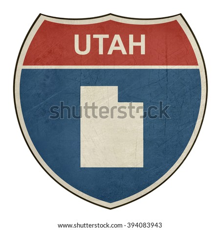 Grunge Utah American interstate highway road shield isolated on a white background. - stock photo