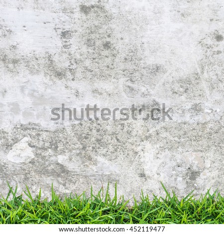 Grunge vintage background of green grass and concrete texture. - stock photo