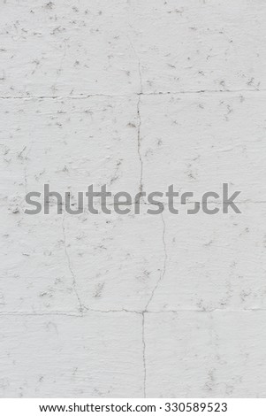 Grunge wall background texture with cracked discolored white paint and damp spots in a full frame view - stock photo