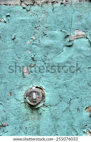Grunge wall with cracked paint  an old electric switch - stock photo