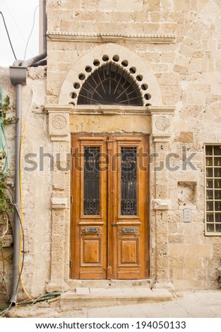Grunge Wooden Decorated  Door in old Arabic House  - stock photo