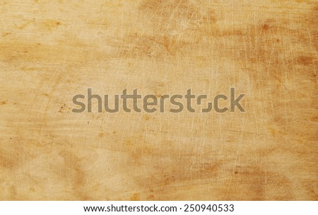 Grunge wooden kitchen cutting board  - stock photo