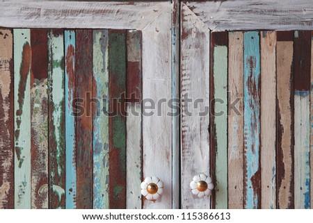 grunge wooden panel door with vintage holder. - stock photo