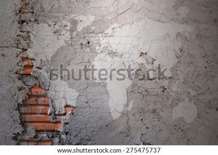 Grunge world map on cracked cement wall texture background - stock photo