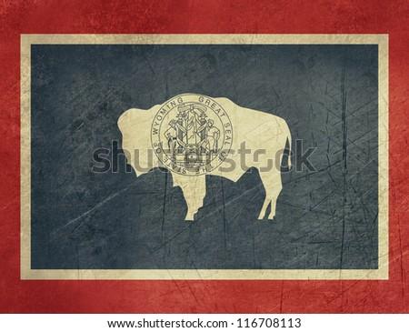 Grunge Wyoming state flag of America, isolated on white background. - stock photo