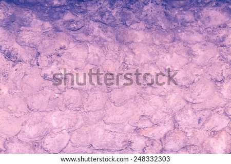 Grungy brickwork with cracks and chipped shot close-up, color tinting - stock photo