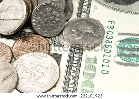 Grungy coins and cash close-up. Please see my portfolio for more concept images with money.  Here are just a few:  - stock photo