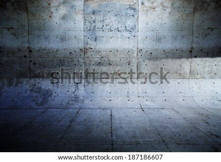 Grungy concrete wall and floor with rounded corners. - stock photo